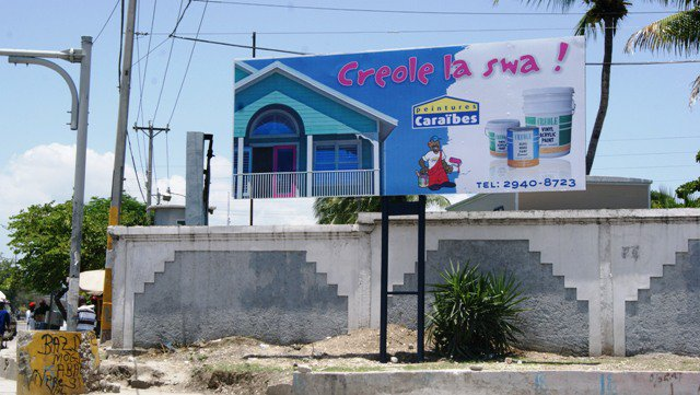 Peintures Caraïbes street billboard sign