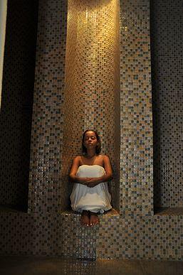 woman in steam at botanik spa in karibe hotel