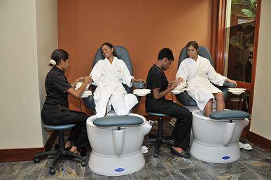 women receiving a manicure