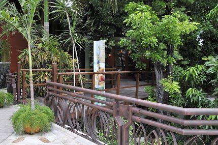 the garden walkway area at the karibe hotel