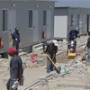 workers preparing ground for paving